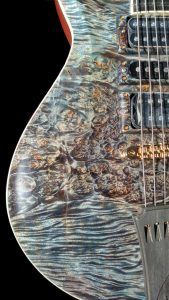 Commissioned Guitar for Christian Vegh. Detailing in finish work by King Blossom Guitars